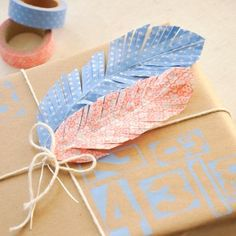 With a little washi tape and some feathers, you'll be in good shape for wrapping presents.