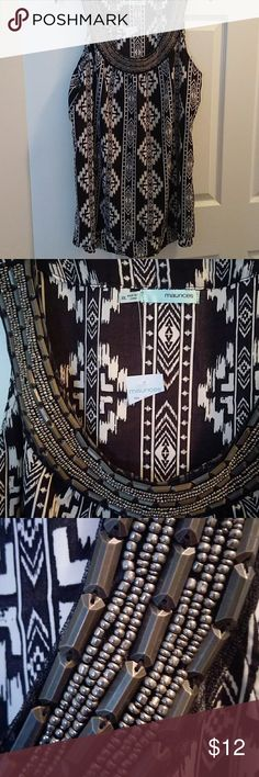 NWT MAURICES BLACK IVORY PRINT BEADED TOP SHIRT Brand new with tags. Super cute beaded neckline black ivory print sleeveless. Maurices Tops Tunics