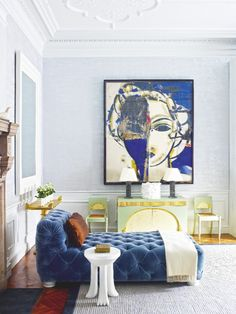 The blue tufted sofa is the center piece of this contemporary living room