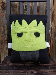 Frankensteins monster as a pillow! Pillow measures approximately 14 x 12 inches Made entirely from top quality fleece with some felt details.