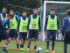Domenico Berardi of Italy (C) looks on during the training session at the club's training ground at Coverciano on February 22, 2017 in Florence, Italy.
