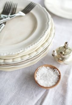 Mismatched whites will always look like a set, and make details pop when entertaining.  Texture details, such as scalloped edges, can add character to a table setting without being distracting.