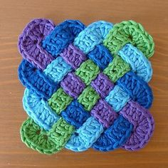 These coasters are made by interleaving four rectangular crochet strips. You only need a small amount of of yarn. Ideally made with four or at least two colours as you will see from the photographs.
