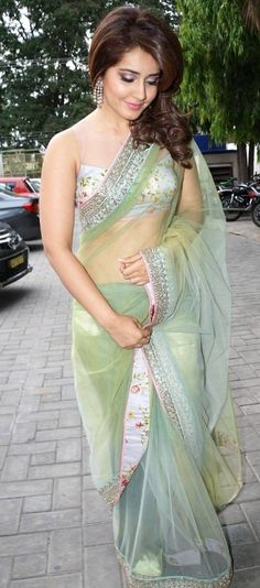 Rashi Khanna In Transparent Green Saree At Lakme Fashion Week Photos