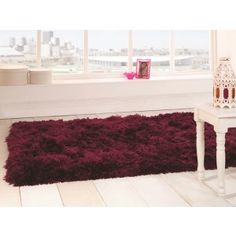 Add a bright decorative piece to your contemporary home decor with this Sumptuous Plum Plain Shaggy Rug.