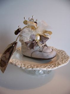 Adorable vintage baby shoe for a baby shower centerpiece or as scattered decor.