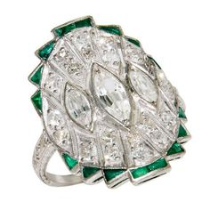 Art Deco Platinum Diamond & Emerald Ring  USA  1930  Wonderful Art Deco, Platinum Diamond and Emerald Ring, with Round and Marquise Diamonds and Fancy cut Emeralds. Diamond weight Total = 1.50 Carats.  Price