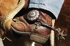 Love those cowboy boots and spurs!