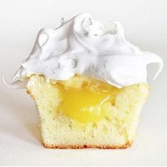 Lemon Meringue Cupcake (now with the recipe):     CUPCAKES  1 1/2 cup cake flour  1 1/2 tsp baking powder  1/4 tsp salt  1 stick butter, room temp  1 cup sugar  2 eggs  1/2 tsp vanilla  1/2 cup milk    Mix flour, baking powder, and salt.  Beat in butter gradually.  Beat in sugar and mix thoroughly.  Beat in eggs, then vanilla and milk.  Beat just until mixed. Pour into lined cupcake pan. Bake at 400 for 20 minutes, or until toothpick comes out almost clean.    FILLING  1 egg
