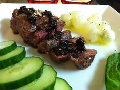 DJ Dave Diner 7/12 Filet w/Blackberry Basil Wine Reduction - Putting my mad scientist mind to action, with a sweet meets spicy reduction of blackberries, basil, habanero sugar, Cabernet Sauvignon and smoked salt. Buttered, grilled pearl onions with black truffle salt, and English cucumber on the side.