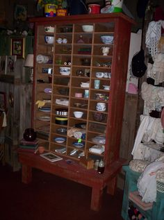 This is a huge cubby hole cabinet, great piece to display all your prim collectables