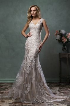 Wedding dress Pia - AmeliaSposa.  This ultra feminine dress exudes splendor and tenderness. Its extremely tempting silhouette with a provocative cleavage and semi-transparent back, sheer fabrics embroidered with laces and nude lingerie dress emphasize women's shapes.