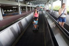 Guide to Universal Orlando Parking: Stroller on the Moving Walkway is not allowed.