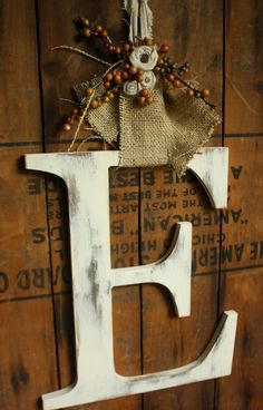 Monogram door decoration with burlap, and autumnal decorations; change out the ribbon, etc for other spring, summer, winter