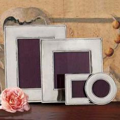 Match Picture Frames! I would love to have all our displayed photos in matching, mirrored frames. I think it will brighten our small space with all the wonderful reflecting :)