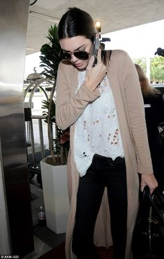 Comfortable: Kendall looked cozy in a flowing, long-sleeved tan cardigan sweater ...