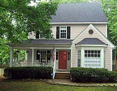 red front door? | tan house, black shutters and garage doors