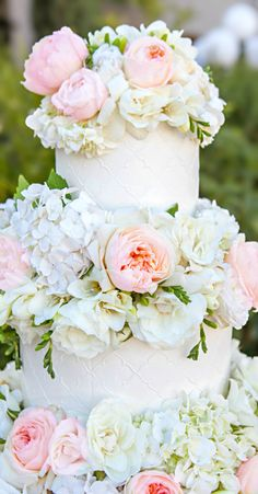 Wedding ● Cake.  Lovely flowers but they do over power the cake it's self. You hardly see it or is that the idea?