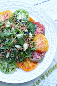 Heirloom Tomato Salad #recipe with Crisped Farro, Arugula and Cucumber. Dressed with Italian vinaigrette.