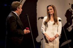 High Commissioner for Refugees António Guterres presents a gold pin to Angelina Jolie to commemorate her 10 years of service as UNHCR Goodwill Ambassador © UNHCR/J.Tanner