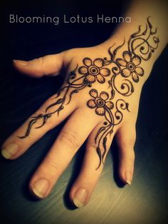 Tri-Flower and Vines Henna by Blooming Lotus Henna and Ana Warren Photography, via Flickr
