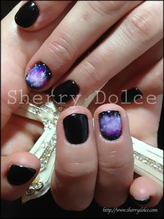 Galaxy Nails! This looks sweet, although I would add a shooting star across the other fingers. Plain black looks strange compared to the galaxy...