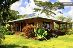 "A rural ""green"" cottage on 6 acres of land in Pahoa,Hawaii is completely solar  powered, and has sliding walls to use trade winds as a natural cooling system."