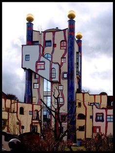 """The Hundertwasser-House in Plochingen/Germany. The design of the building complex was inspired by the art of Friedensreich Hundertwasser. This particular piece in the center is called the """"Regenturm"""" (the raintower). Unusual Buildings, Interesting Buildings, Amazing Buildings, Friedensreich Hundertwasser, Unusual Homes, Unique Architecture, Street Art, Germany, Tower"""