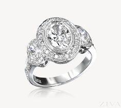 Oval 3-Stone Ring Bezel Set in Diamond Halos