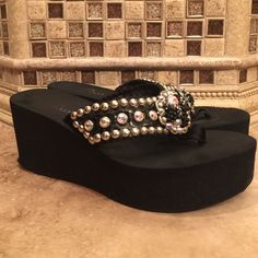 Swarovski Crystal Sandals Worn a few times! I lady in Texas hand made these sandals out of Swarovski crystals. The wedge is about three inches tall and they are super comfy! No trades please. Shoes Sandals