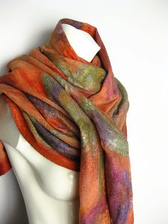 Nuno is a Japanese word for cloth or fabric, it is used to describe felting onto fabric. Hand felted with super soft merino wool and silk, onto