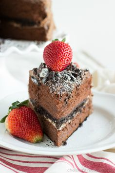 A decadent chocolate cake made with ice cream with an inside oreo truffle layer. This double layered cake is frosted with a delicious chocolate cream cheese frosting, topped with crushed oreos, and sprinkled with powdered sugar.