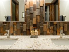 Reclaimed wood instead of tile is storming the market right now. We love the varying colors and sizes in this modern bathroom.