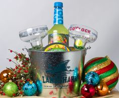 "For the Margarita lover on your list! Party Bucket, Margarita Mix, Salt Caddy and two ""Five O'clock Somewhere"" glasses from Jimmy Buffett's Margaritaville! $29.95"