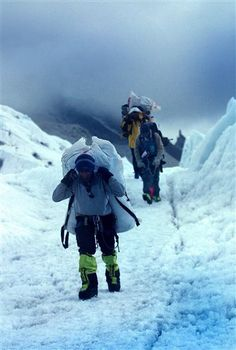 FILE - In this May 24, 2003 file photo, Nepalese Sherpas with luggage make their way through the Khumbu Icefall to Everest base camp in Nepal. (AP Photo/Gurinder Osan, File) ▼1May2015AP|Sherpas face uncertain future following Everest avalanche http://bigstory.ap.org/article/1642a1e1c96a4522b9f6551c4cdf9aa1/sherpas-face-uncertain-future-following-everest-avalanche