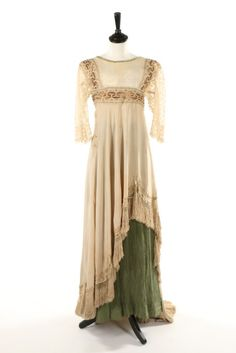Circa 1912 ivory silk crepe overdress with Greek key embroidery and green tree bark crepe skirt.