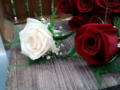 White and red rose boutonniere by Superior Hy-Vee.