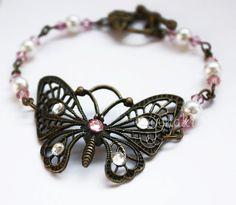 Bracelet papillon strass rose/blanc Butterfly bracelet with pink and white strass  http://facebook.com/yunaki.crea http://instagram.com/isa_yunaki http://twitter.com/isa_yunaki