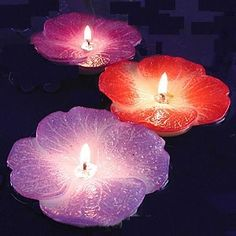 definitely want some purple and creme colored floating candles in the pond :)