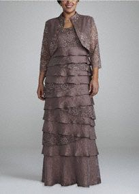 You will shine is this gorgeous long lace shimmer dress!  Sleeveless bodice features elegant empire waist creating a slimming silhouette.  Multi tiered skirt adds dimension and flare.  Lace shimmer fabric is eye-catching and stunning.  3/4 sleeve jacket adds just the right amount of coverage.  Fully lined. Back zip. Imported rayon/nylon/metallic blend. Spot clean.