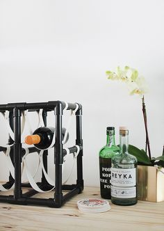 This DIY leather and pipe wine rack is a great way to add a contemporary homemade touch to your dining room, kitchen or bar area. It's an easy, convenient and decorative way to prep for your next party, or to store bottles for longterm use.
