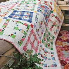 Good Morning  Designed by HOLLY HOLDERMAN Made by DARLA PADILLA & DONNA NECKRITZ Machine Quilted by DARLA PADILLA.  Skill Level:  CONFIDENT BEGINNER  Finished Size 59½˝ x 82½˝  Kit Offer  A kit of fabrics for quilt top and binding is available while supplies last for $109.99 ppd. (TX residents, $118.24 ppd.) from Fat Quarter Shop™, PO Box 1544, Manchaca, TX 78652; 866-826-2069; FatQuarterShop.com.