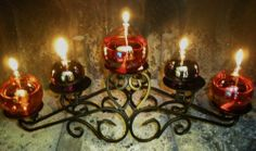 """5 Glass Oil Candle Lamps and Stand by Northwest Glass. $79.00. holiday tables. long lasting fiberglass wicks and funnels included. mantles and fireplaces. weddings. burns clean smokeless odorless liquid parafin. This set includes an elegant 5 Place pillar candle holder with three, 4"""" glass oil candle balls and two 3"""" glass oil candle balls. They are clear iridescent glass, shown filled with colored lamp oil  Great for mantles, fireplaces, centerpieces. Save 20%!"""