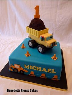 """Happy First Birthday Michael! This is the Construction themed birthday cake from this past weekend it is based on the cake I made my son his last birthday. Big dump truck on a square this time and hand cut trucks """"moving"""" around the sides. Dump Truck Cakes, Truck Birthday Cakes, First Birthday Cakes, 2nd Birthday, Birthday Ideas, Dump Trucks, Cupcakes, Cupcake Cakes, Birthday Cakes"""