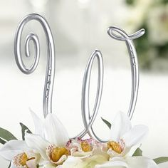 No cake is complete without the perfect topper. Sleek in silver, this silver rhinestone initial cake topper is all stylish sophistication.