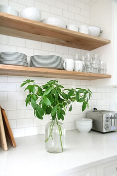 wood shelving + white subway tile + marble countertop