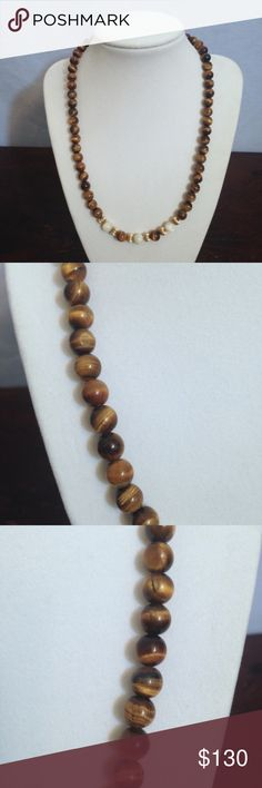 "Vintage 60's Tiger's Eye Bead Necklace Vintage Mid-Century 1960's Tiger's Eye beaded necklace with gold fill & milky white accent beads, which I believe are White Jade. Beads are 7mm. Fishhook clasp marked with ""14KGF"". 28"" long. Beautiful condition! Vintage Jewelry Necklaces"