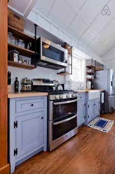 Blue timber kitchen in Small Cottage in Nashville