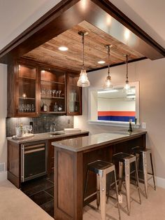 Barn wood on the ceiling of this home bar completes the look.