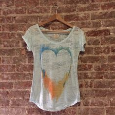 Light Blue AE Burnout Tee Stylish Light blue burnout tee from American Eagle. Has graffiti blue/green/orange/yellow heart on front  Great summertime top. Looks cute with boyfriend jeans and shorts.  Good top for the beach! Has been worn but in good condition. American Eagle Outfitters Tops Tees - Short Sleeve